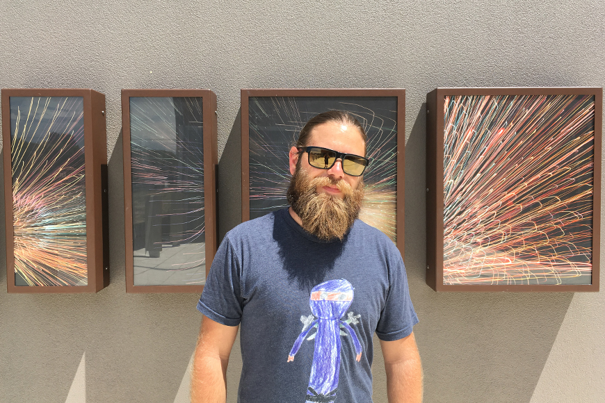 Matt Dixon with artwork