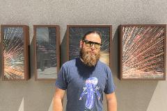 Matt Dixon with artwork