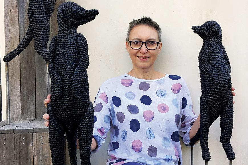 Artist Mikaela Castledine with meerkats
